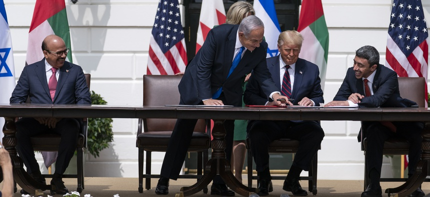 Bahrain Foreign Min. Khalid bin Ahmed Al Khalifa, left, Israeli Prime Minister Benjamin Netanyahu, President Donald Trump, and UAE Foreign Min. Abdullah bin Zayed al-Nahyan at the Abraham Accords signing, the White House, Tuesday, Sept. 15, 2020.