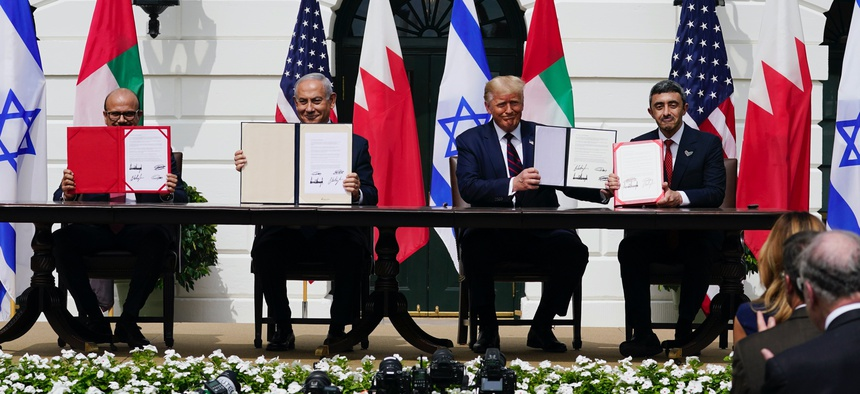 Leaders display a signed agreement at the White House on Sept. 15, 2020.