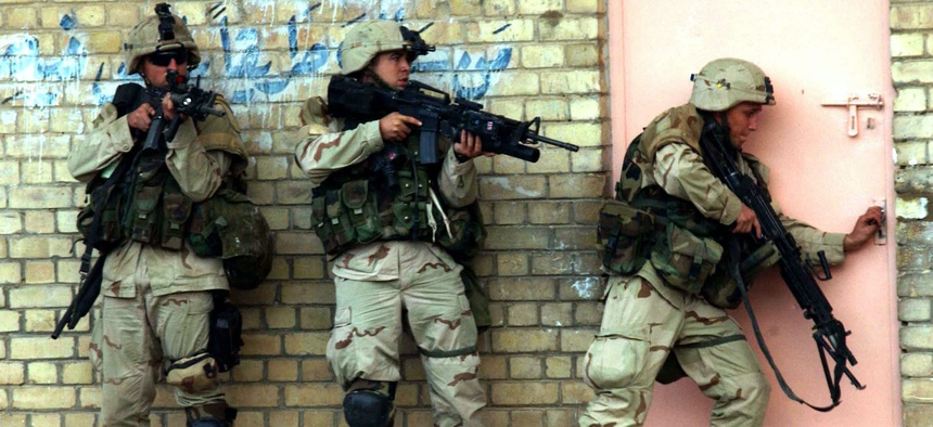 U.S. soldiers clear a building during fighting in Fallujah, Iraq, in November 2004.