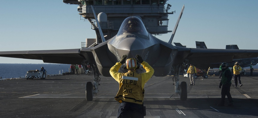An F-35C Lightning II is prepared for launch aboard the aircraft carrier USS Nimitz (CVN 68) in the Pacific Ocean, Nov. 4, 2014.
