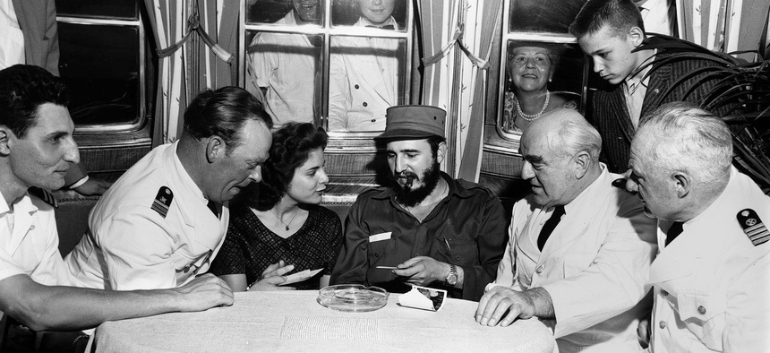 Fidel Castro aboard MS Berlin North German Lloyd cruise ship in Havana harbor. Left to right: First officer Ernest Hankiewicz; captain's daughter Marita Lorenz; Castro; Capt. Heinrich Lorenz, chief enginer Karl Kase.