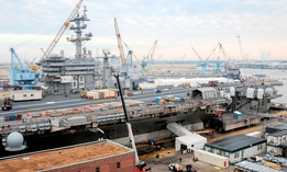 The aircraft carrier USS Dwight D. Eisenhower (CVN 69) sits in dry dock during a 14-month scheduled docking planned incremental availability at Norfolk Naval Shipyard.
