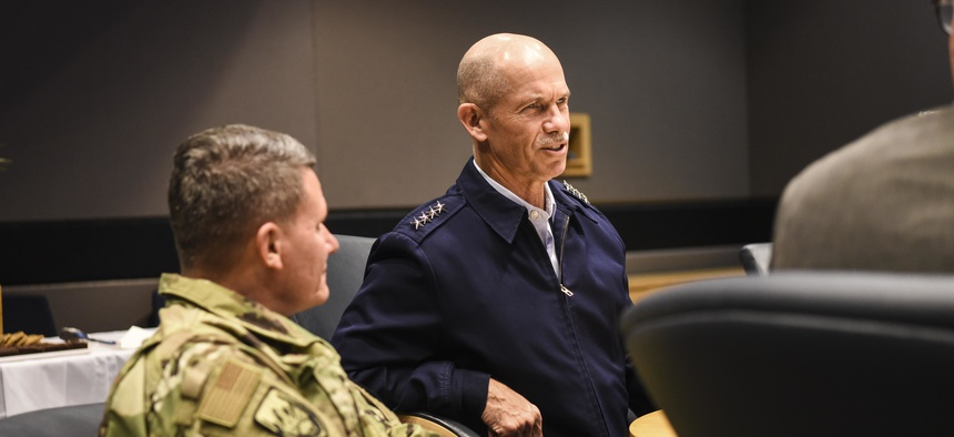 U.S. Coast Guard Vice Commandant Charles Ray speaks with members of Lockheed Martin and Defense Contract Management Agency Col. Lance French at a briefing at the Lockheed Martin facility in Marietta, Ga., Oct. 23, 2018.