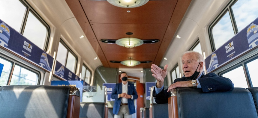 Democratic presidential candidate former Vice President Joe Biden speaks with United Steelworkers Union President Thomas Conway and school teacher Denny Flora of New Castle, Pa., aboard his train as it travels to Pittsburgh, Wed., Sept. 30, 2020.