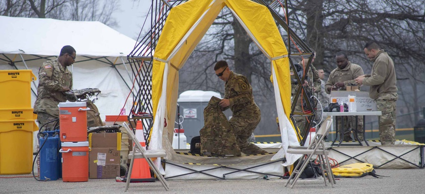 Pennsylvania Air National Guardsmen set up gear at a mass coronavirus test center in Upper Dublin Township, Pa., March 20, 2020.