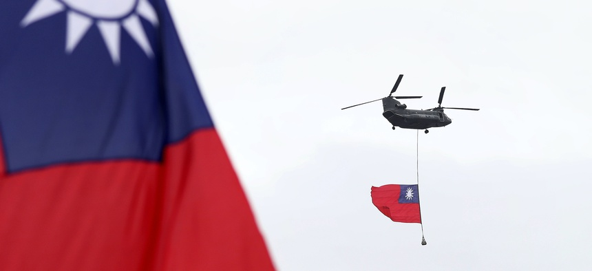 Helicopters fly Taiwan's flag during the National Day celebrations in Taipei on Oct. 10, 2020.