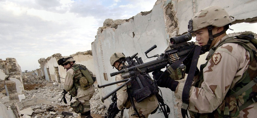 U.S. Army soldiers search for insurgents suspected of planting a roadside bomb in Mosul, Iraq Sunday, Nov. 21, 2004.