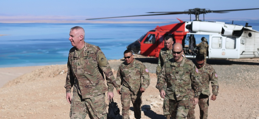 Maj. Gen. John Sullivan, commanding general, 1st Theater Sustainment Command, visits with soldiers assigned to Task Force Sinai in Egypt in 2019.