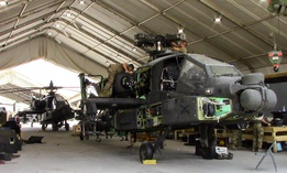 Soldiers work on an AH-64E Apache  at Camp Taji Military Complex, Iraq, in July 2017.