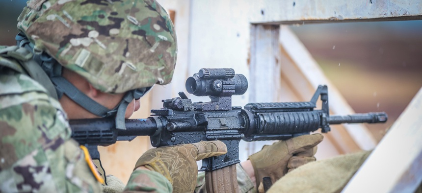 "SCHOFIELD BARRACKS, Hawaii – Soldier with 25th Infantry Division Artillery ""DIVARTY"" gets ready to fire his M4 rifle during an M4 qualification range on Oct. 15, 2020 at Schofield Barracks, Hawaii."