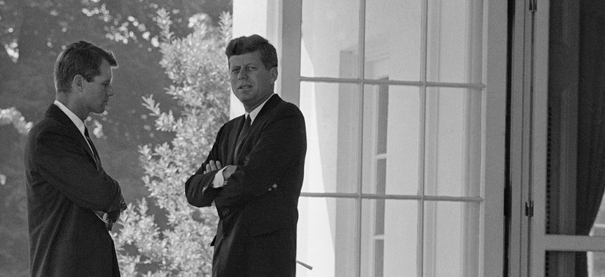 President John F. Kennedy, right, confers with his brother Attorney General Robert F. Kennedy at the White House in Washington, D.C., on Oct. 1, 1962.
