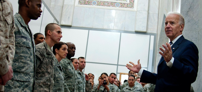 Then-U.S. Vice President Joe Biden talks with troops at Victory Base Complex, Iraq, in 2011.