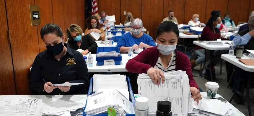 Election workers sort ballots at the Dauphin County Administration Building in Harrisburg, Pennsylvania, on Nov. 3, 2020.