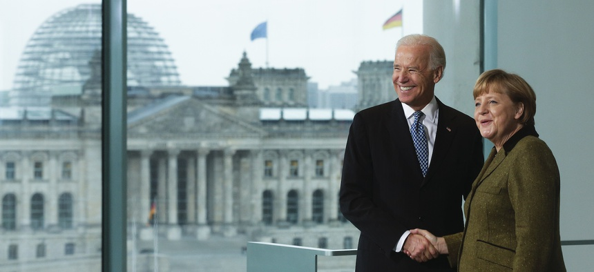 German Chancellor Angela Merkel, right, and United States' Vice President Joe Biden brief the media prior to a meeting at the chancellery in Berlin, Germany, Friday, Feb. 1, 2013.