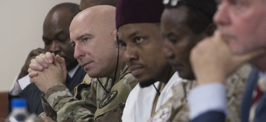 NIAMEY, Niger - Lt. Col. Charles Lewis, defense attaché, U.S. Embassy Niamey, alongside representatives from partner nations Chad and Denmark, listens to opening remarks made at the Senior Leadership Seminar for Flintlock 2018 in Niamey Niger Apr. 9, 2018