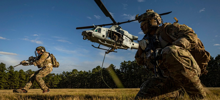 Special warfare airmen assigned to the New Jersey Air National Guard participate in fast-rope training with a Marine Corps UH-1Y Venom helicopter at Joint Base McGuire-Dix-Lakehurst, N.J., Oct. 10, 2019.
