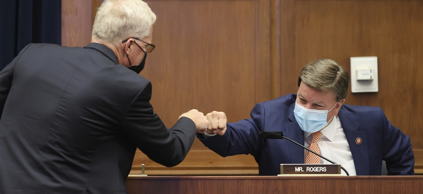 Now-Defense Secretary Christopher Miller, left, greets committee ranking member Rep. Mike Rogers, R-Ala., before a House Committee on Homeland Security hearing on 'worldwide threats to the homeland', Thursday, Sept. 17, 2020 on Capitol Hill Washington.