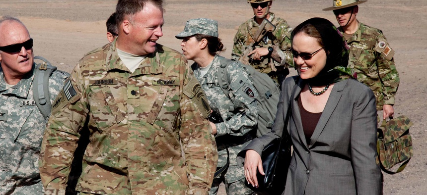 Lt. Col. Steven Johnson, Special Operations Task Force-West, commander greets Michele Flournoy, Undersecretary of Defense for Policy, upon arrival at a firebase in Shindand District, Afghanistan, April 13, 2011.
