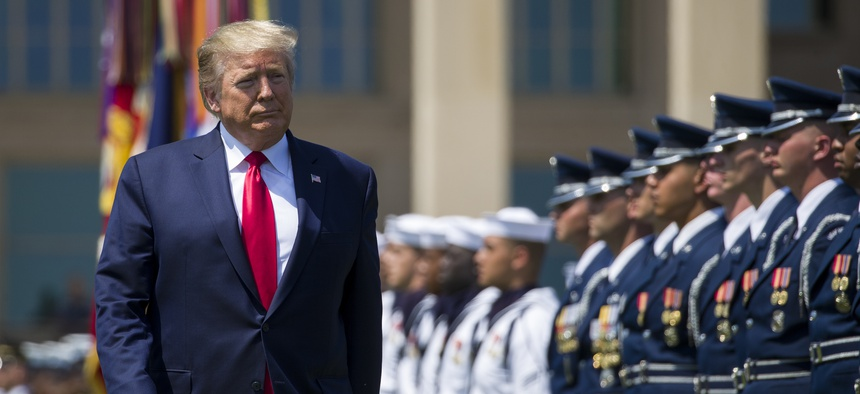 In this July 25, 2019, file photo, President Donald Trump reviews the troops during a full honors welcoming ceremony for Secretary of Defense Mark Esper at the Pentagon in Washington.