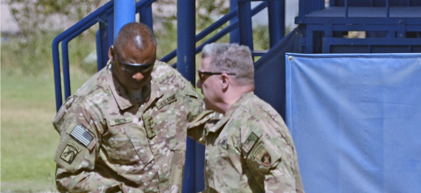 Then-U.S. Army Lt. Gen. Mark Milley, commander of International Security Assistance Force-Joint Command, greets then-Gen. Lloyd Austin, commander of U.S. Central Command, in Kabul, Afghanistan, in 2013.