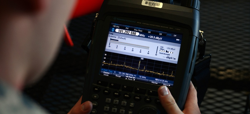 U.S. Air Force Staff Sgt. Geoffery Smith, 20th Communications Squadron installation spectrum manager, views the display on a radio spectrum analyzer at Shaw Air Force Base, S.C., Jan. 13, 2017.