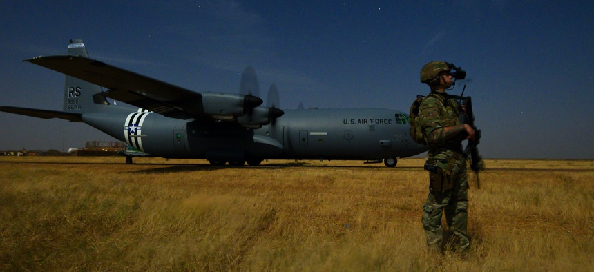 Army Spc. Christopher Andres, an Oregon National Guardsman assigned to the 41st Infantry Brigade Combat Team, provides security for an Air Force C-130J Super Hercules during unloading and loading operations in Somalia, Feb. 6, 2020.