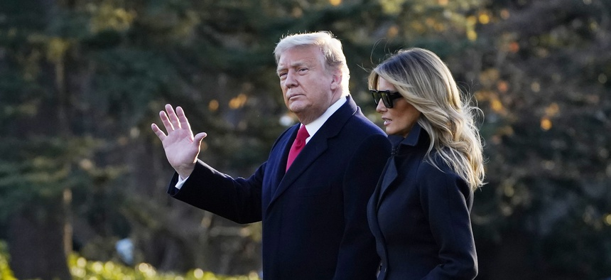 President Donald Trump and first lady Melania Trump walk to board Marine One on the South Lawn of the White House, Wednesday, Dec. 23, 2020, in Washington.