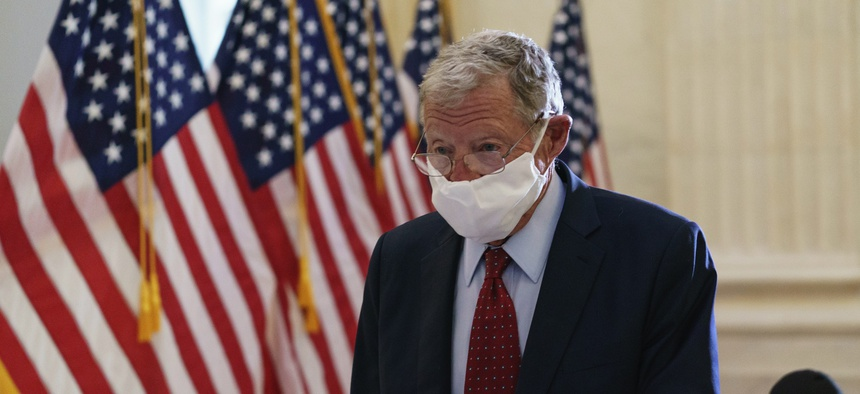 Senate Armed Services Committee Chairman Sen. Jim Inhofe, R-Okla., arrives as Senate Republicans hold leadership elections, on Capitol Hill in Washington on Nov. 10, 2020.