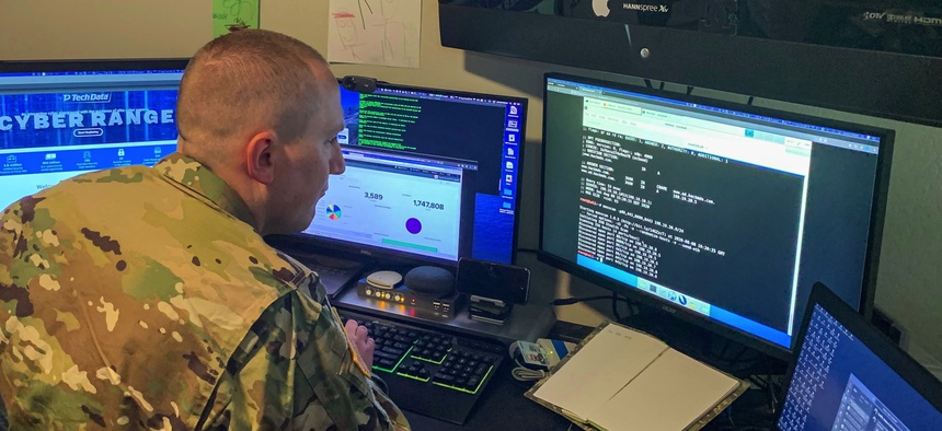"A cyber officer with the Army Reserve's Cyber Protection Team 185, uses a common network scanning tool called ""masscan"" to enumerate a network during his unit's virtual battle assembly at Joint Base Langley-Eustis, Va., Aug. 9, 2020."
