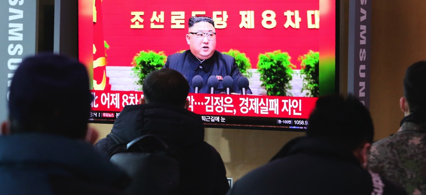 People watch a TV screen showing North Korean leader Kim Jong Un during a ruling party congress, at the Seoul Railway Station in Seoul, South Korea, Wednesday, Jan. 6, 2021.