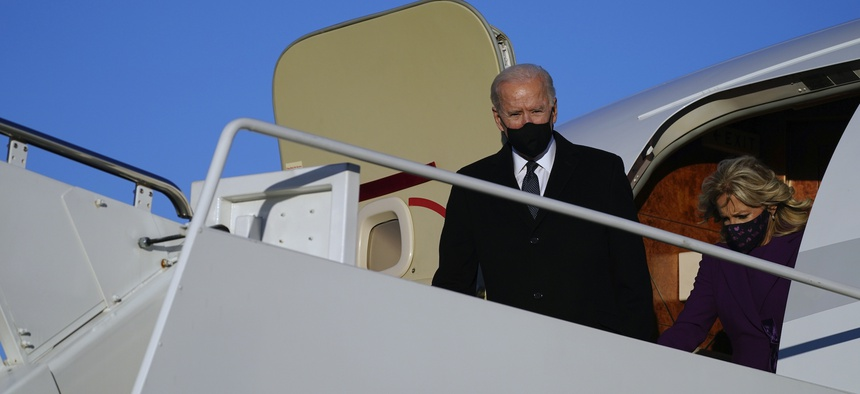 President-elect Joe Biden and his wife Jill Biden arrive at Andrews Air Force Base, Tuesday, Jan. 19, 2021, in Andrews Air Force Base, Md