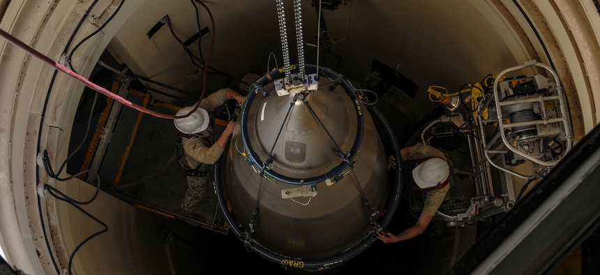 Airmen from the 90th Missile Maintenance Squadron prepare a reentry system for removal from a launch facility, Feb. 2, 2018, in the F. E. Warren Air Force Base missile complex.