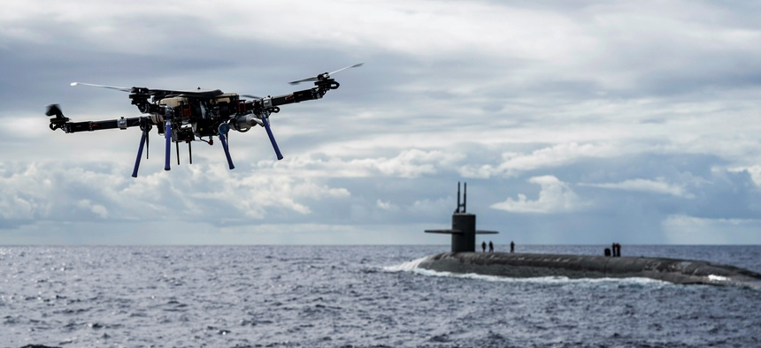 An unmanned aerial vehicle delivers a payload to the ballistic missile submarine USS Henry M. Jackson around the Hawaiian Islands, Oct. 19, 2020.