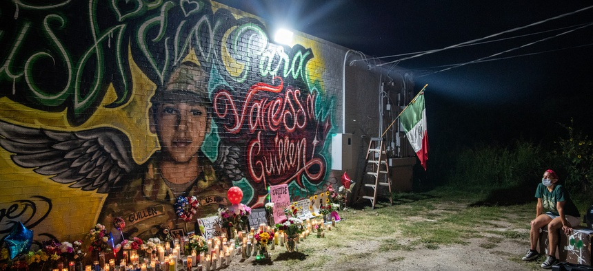 People pay respects at a mural of Vanessa Guillen, a soldier based at nearby Fort Hood on July 6, 2020 in Austin, Texas.