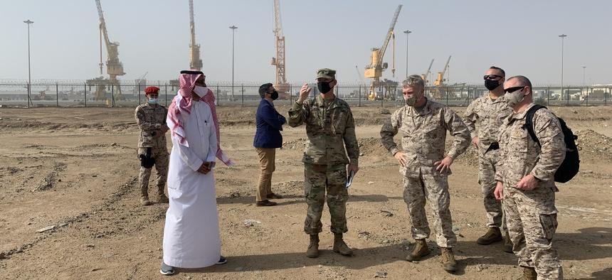 Gen. McKenzie inspects an industrial port site in Saudi Arabia.