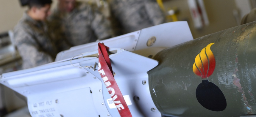 Airmen reviews safety precautions before building GBU-12 Paveway II laser-guided bombs at Creech Air Force Base.