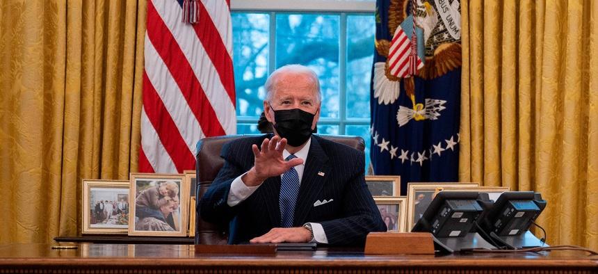 President Joe Biden speaks with Secretary of Defense Lloyd Austin (R) in the Oval Office of the White House in Washington, DC, on January 25, 2021.