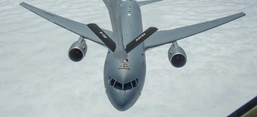 A KC-135 refuels a KC-46 over the Atlantic Ocean.