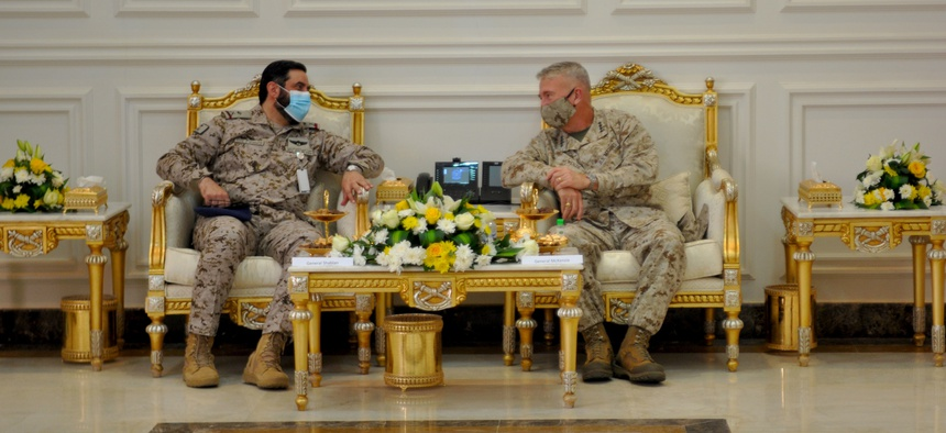 U.S. Marine Corps Gen Frank McKenzie, CDR, U.S. Central Command sits with Saudi Arabian Maj. Gen. Khalid bin Abdullah AlShablan, commander, Prince Sultan Air Base, during a visit to Prince Sultan Air Base, Kingdom of Saudi Arabia, July 9, 2020.