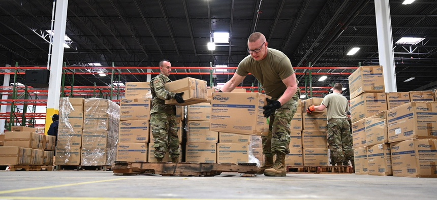 Members of the Maryland Air National Guard prepare medical supplies for transport at the Maryland Strategic National Stockpile location on March 19, 2020.