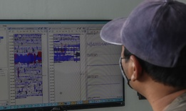 LUMAJANG, INDONESIA, JANUARY 17: An official monitors the seismograph used to monitor the eruption of Mount Semeru in Lumajang, East Java Province, on January 17, 2021. Mount Semeru erupted on January 16, 2021