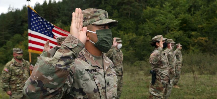 Soldiers from the U.S. Army National Guard and U.S. Army Reserve participate in a reenlistment ceremony Sept. 26, 2020, near Ferizaj/Urosevac, Kosovo.
