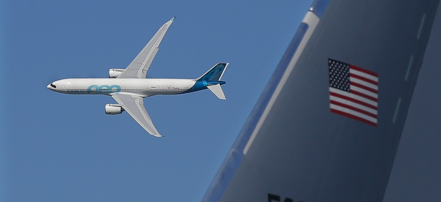 An Airbus A330neo flies past a Boeing KC-46 tanker at the 2019 Paris Air Show.