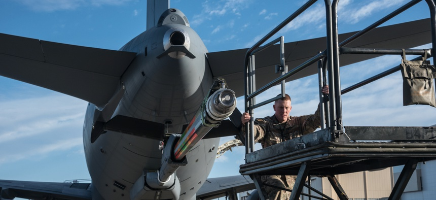 Master Sgt. Chris Hughes, 22nd Maintenance Squadron hydraulics craftsman, climbs onto a B4 stand to begin an acceptance inspection on a KC-46A Pegasus boom Feb. 14, 2019, at McConnell Air Force Base.