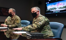 Gen. Mark A. Milley, chairman of the Joint Chiefs of Staff, and Gen. Glen D. VanHerck, commander of USNORTHCOM, talk at Peterson Air Force Base, Colorado Springs, Colo, March 1, 2021.