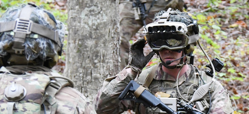 Soldiers from the 82nd Airborne Division use the latest prototype of the Integrated Visual Augmentation System during a trench clearing exercise in October at Fort Pickett, Va.