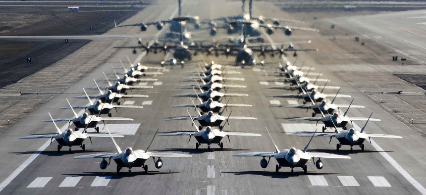 """U.S. Air Force aircraft participate in a close formation taxi known as an """"elephant walk"""" at Joint Base Elmendorf-Richardson, Alaska, May 5, 2020."""